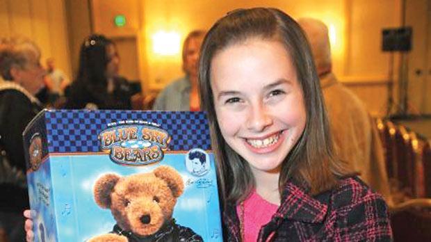 Isabella Scott holding an Elvis Presley teddy bear.