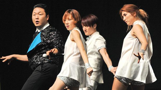South Korean K-pop star Psy performs during his public appearance in Singapore yesterday. Photo: AFP