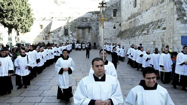 Clergy gathering in Manger Square outside the Church of the Nativity.