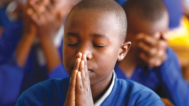World greetings to madiba a kenyan pupil praying for the former south african president during celebrations to mark nelson mandela m4hsunfo