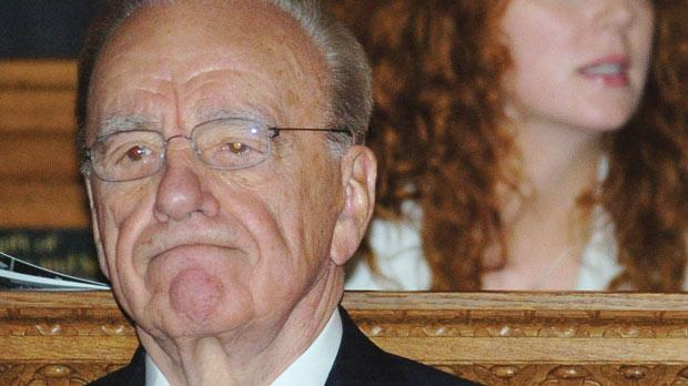 Rupert Murdoch sitting in front of Rebekah Brooks at a service at St Bride's Church, Fleet Street, London on June 15, 2005.