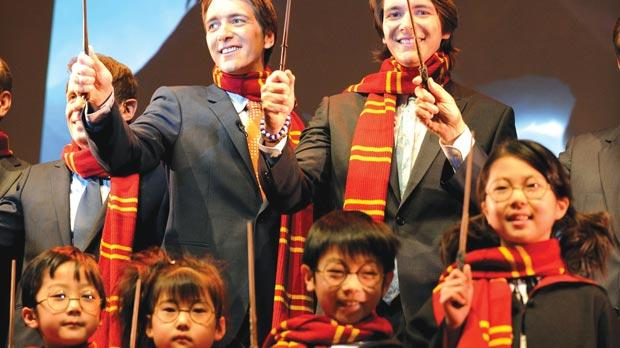 Twin actors James and Oliver Phelps (centre right and left), who played Fred and George Weasley in all Harry Potter movies, during the theme park announcement at a press presentation in Osaka, Japan.