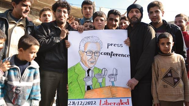 Syrians hold a placard depicting international peace envoy Lakhdar Brahimi delivering a press conference during a demonstration against President Bashar al-Assad in the town of Kfranabel, in the north west province of Idlib yesterday. Photo: AFP