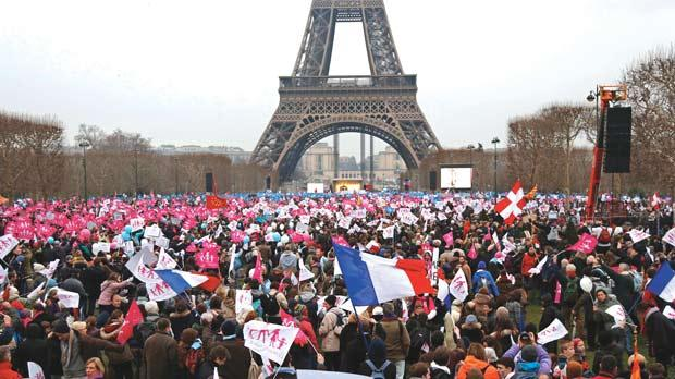 Thousands of demonstrators gather on the Champ de Mars near the Eiffel Tower in Paris to protest France's planned legalisation of same-sex marriage. Photo: Reuters
