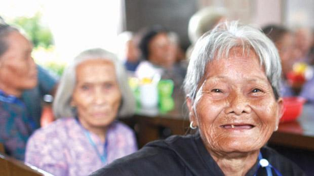 A group of centenarians at a home in Dengmai, south China's Hainan province.