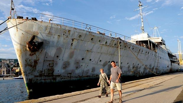 A couple passing by the Galeb, originally used to trnasport bananas and later converted to an auxiliary crusier by the Germans in World War II. Photos: Hrvoje Polan/AFP