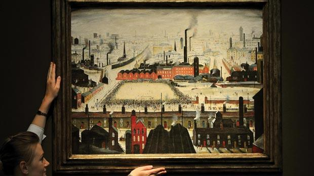 The Football Match by L.S. Lowry (Lawrence Stephen, 1887-1976) on display at Christie's Auctioneers in St James's central London. Photo: John Stillwell/PA Wire